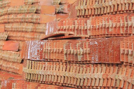 several piles of roof tiles photo