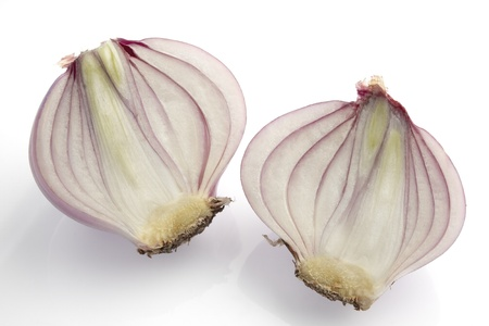 cutting of small red shallot on white background photo