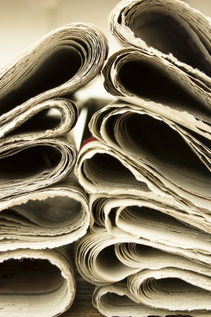 closeup pile of newspaper on wooden background Stock Photo - 18014531
