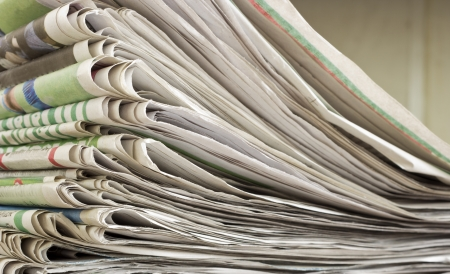 article writing: closeup pile of newspaper on wooden background