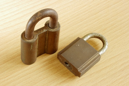 rusty old metal padlock on wooden background Stock Photo - 18214926