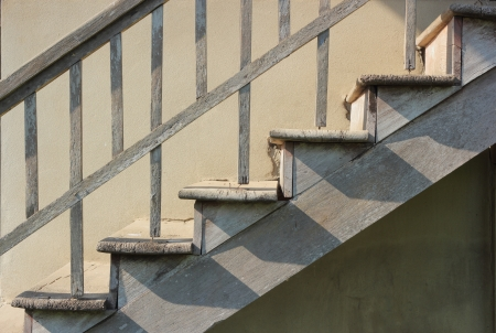 old wooden staircase against concrete wall photo