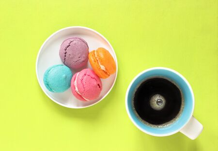 Macarons on a plate and a cup of coffee on green background Stock Photo - 18949178