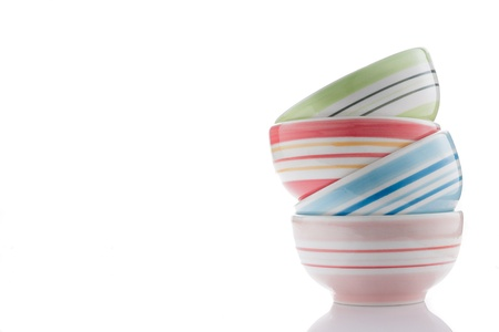 stack of colorful bowls isolated on white background. photo
