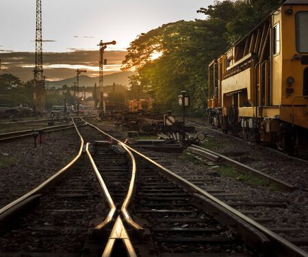 Cargo train platform at sunrise photo