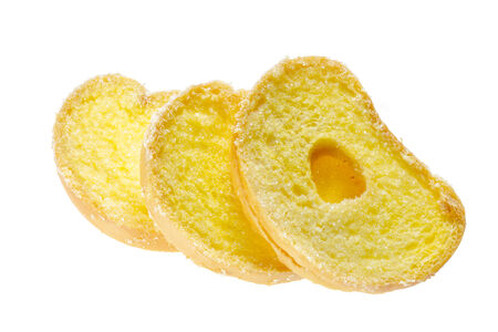 Baked bread, buttered and sprinkled with sugar on white background. Stock Photo