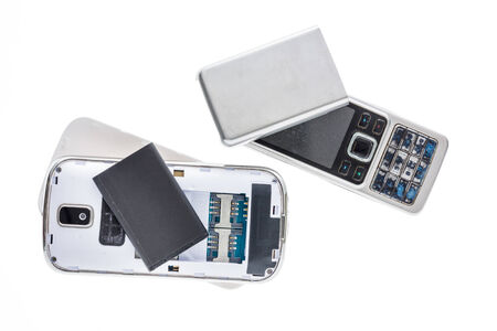 deconstruct: Disassembled old mobile phone isolated on white background.