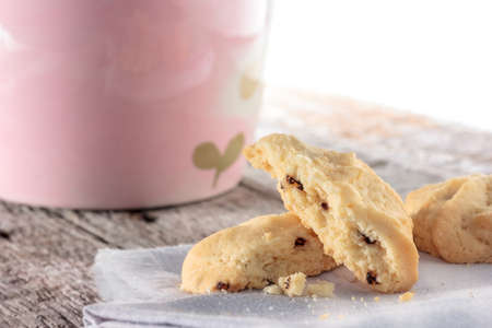 Closeup cookie with napkin on wooden table. photo