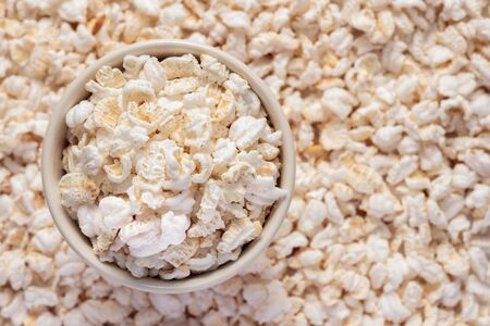 popped: Cup of popped rice as background. Stock Photo