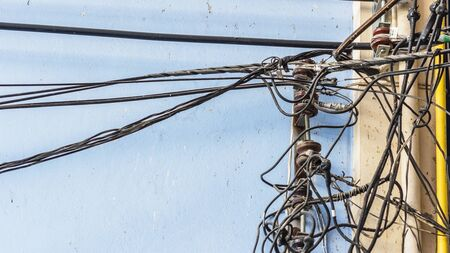 wiring: Pile of electrical wiring on blue wall.