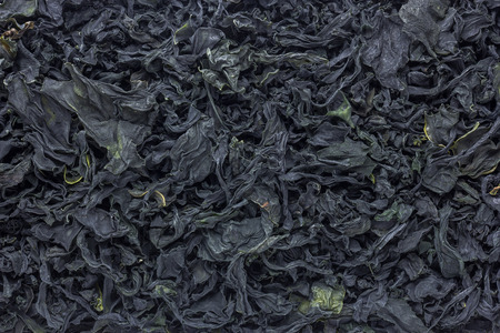 Close up dried wakame seaweed as background.japanese food. Stock Photo