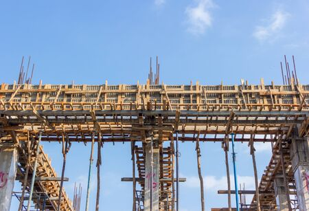 Fragment of a new residential construction home  against  blue sky. Stock Photo
