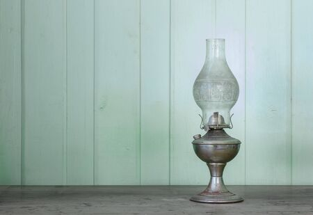 lantern lamp with  soft glow light in  antique wooden wall with aged wood floor.