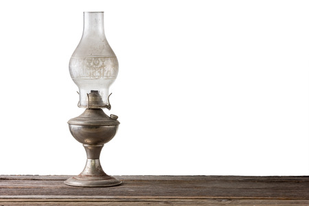 lantern lamp on aged wooden floor isolated on white background with clipping path. Stock Photo