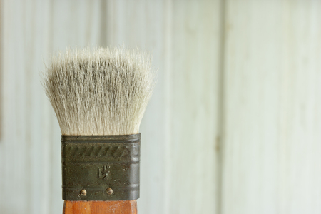 Old brush on wooden background. Editorial