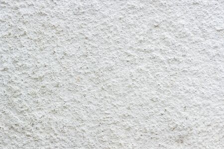 close up grunge texture white paint cement wall.