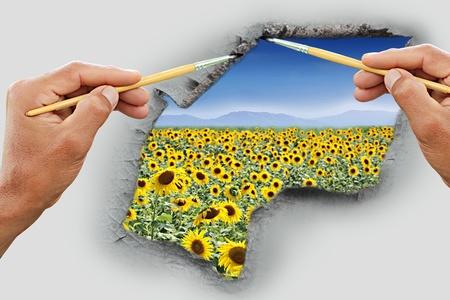 Two hand written sunflower field outside. photo