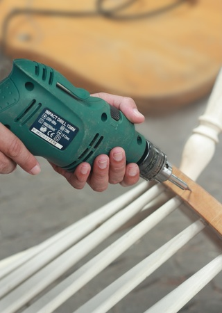 penetrate: Carpenter hand drill to penetrate the wood.