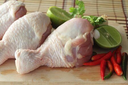Chicken and vegetables prepared for cooking photo