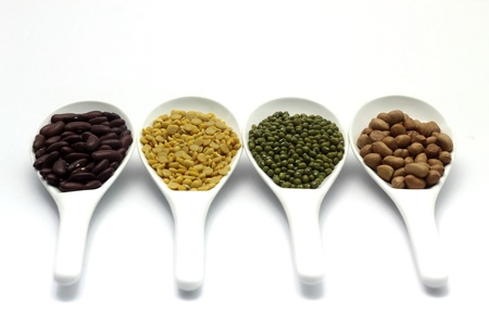 munggo: Red bean, mung beans, Peanut, Soybean in ladle on a white background. Stock Photo
