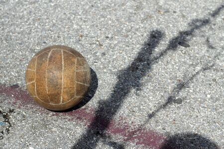 Old volleyball in outdoor courts, Black shadow of the net photo
