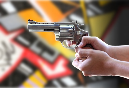 Gun in hand has a background as Graffiti Stock Photo - 11868963
