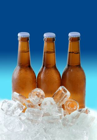 intoxicating: Beer bottles on ice Stock Photo