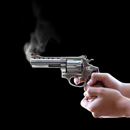 Gun in hand on Black background, Let the smoke out Stock Photo - 12003911