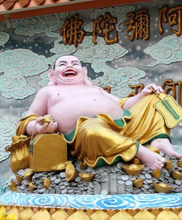 Happy Buddha temple in China photo