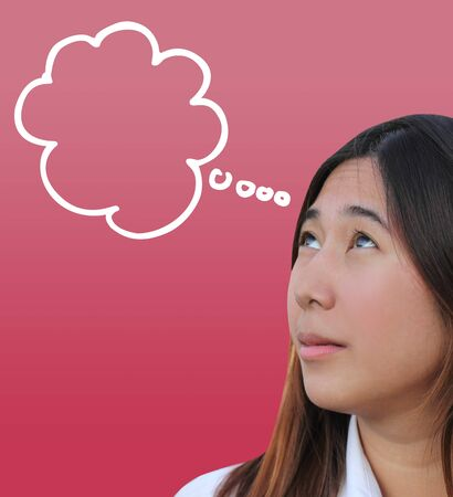 Young women currently being thinking and bubble on pink background photo