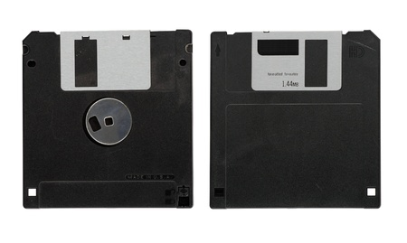 Old diskette on white background photo
