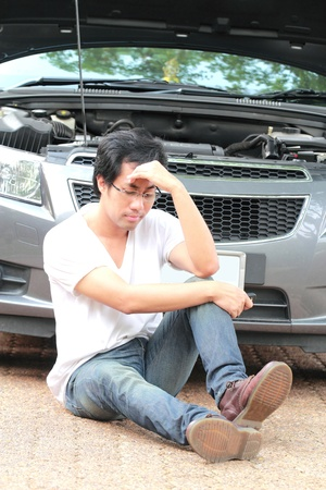 Dismal man when car breakdown photo