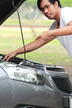 The young man checked the car before you leave Stock Photo - 12782780