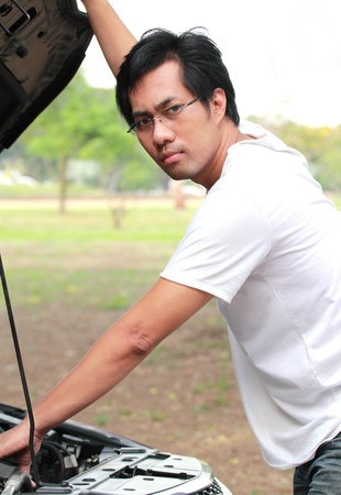The young man checked the car before you leave Stock Photo - 12782773
