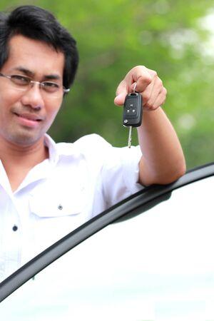 Man show the key Stock Photo - 12782767