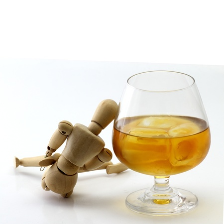 drunkard: Wood model and Glass of brandy concept drunkard Stock Photo