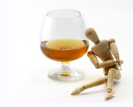 Wood model and Glass of brandy concept drunkard