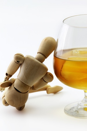 perplexity: Wood model and Glass of brandy concept drunkard Stock Photo