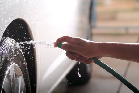 Hand are car washing photo