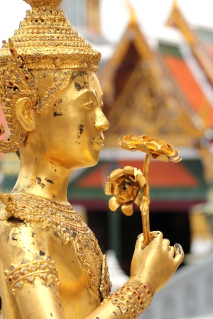 Golden Kinnari statue (Wat Pra Kaew) Stock Photo - 13625252