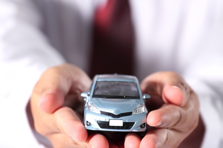 auto garage: The blue car is in businessman hand