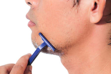 Close up of man is shaving photo