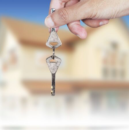 hand holding keys, house background Stock Photo - 14191153