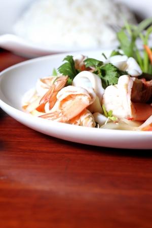 Thai cuisine, shrimp, squid salad mixed. photo