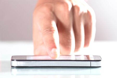 Hand using smartphone that is placed on the desk Stock Photo - 14295305