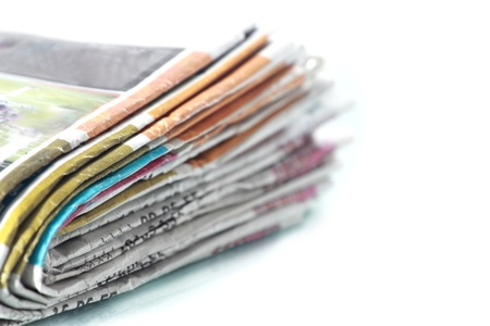 Old newspapers pile up photo