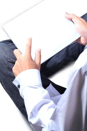 Man is using a digital tablet Stock Photo - 14295313