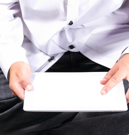 Man is using a digital tablet Stock Photo - 14295296