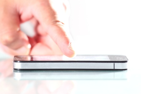 Hand using smartphone that is placed on the desk Stock Photo - 14295297