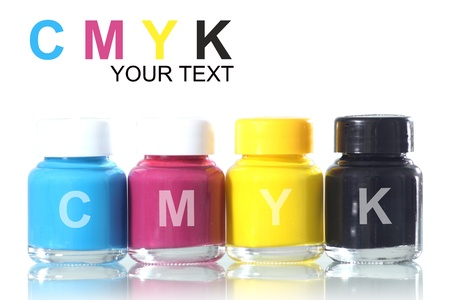 bottles of ink in cmyk colors photo